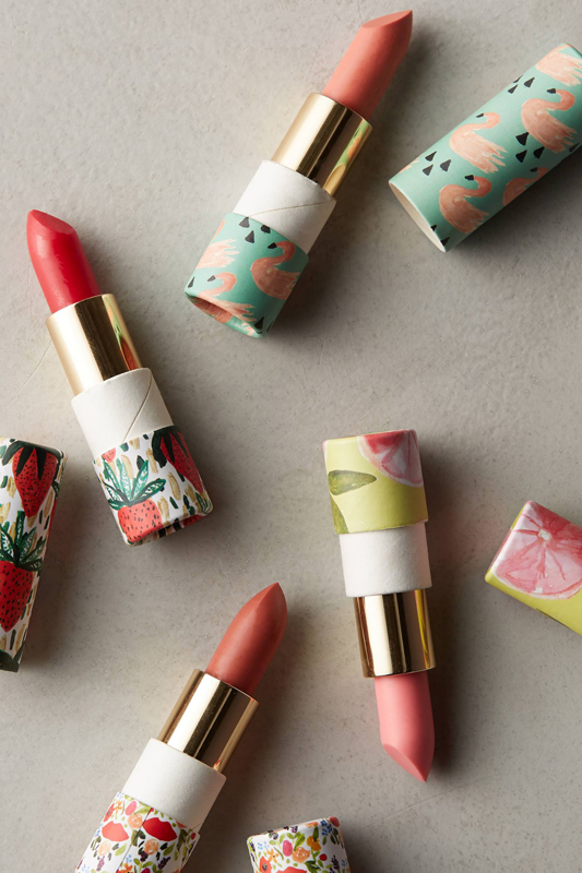 Lip balms with packaging by Kendra Dandy