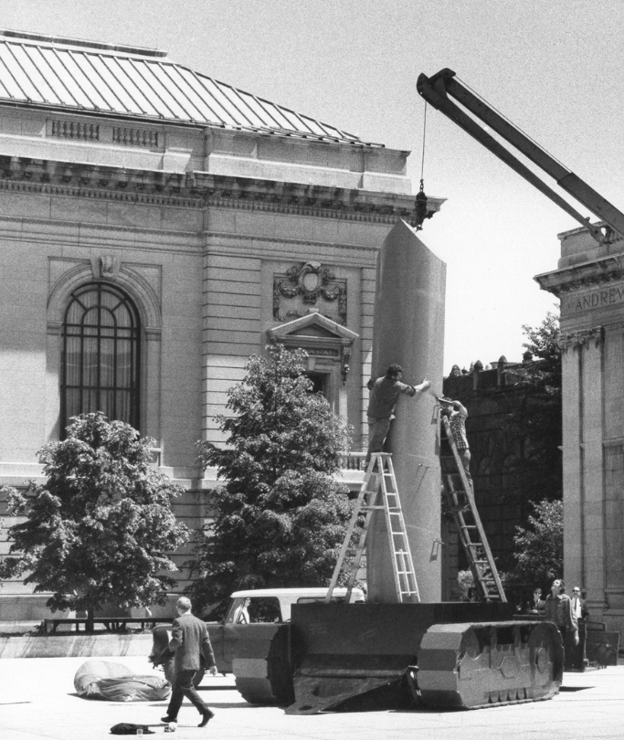 installation photo of Oldenburg's Lipstick (Ascending) on Caterpillar Tracks, May 1969