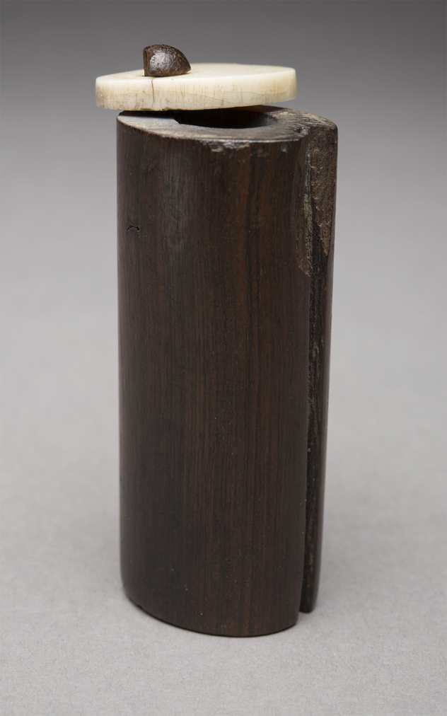 Wood and ivory kohl tube with a swivel lid