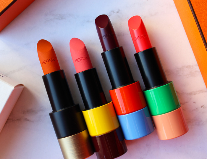 Hermès lipsticks in Orange Boite, Rose Inoui, Violet Insensé, and Corail Fou
