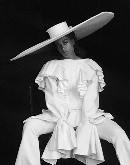Solange in a Harris Reed hat